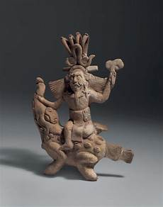 the jaguar god figure of the jaguar god of the underworld ridding a