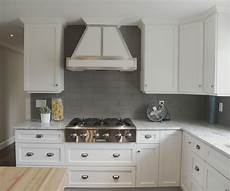 white ceiling fan subway kitchen backsplash ideas white cabinets metal detail on hood fan frosted glass