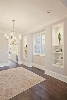warm grey wall paint with white trim pld homes via houzz home builders home custom home