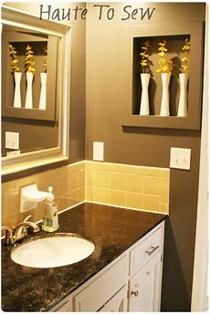 bathroom makeover yellow gray color scheme using the original tiles house decorators