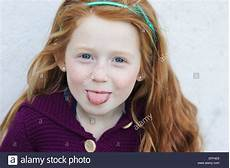 young girl with red hair stock photo image of forest young girl with red hair sticking out tongue stock photo alamy