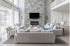 steinwand wohnzimmer grau blue and gray living room with a two story fireplace