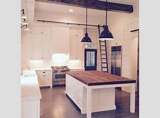 Butcher block island. Marble or quartz on the rest of the