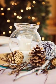 winter wedding centerpieces winter decorations spray paint pine cones use salt to like
