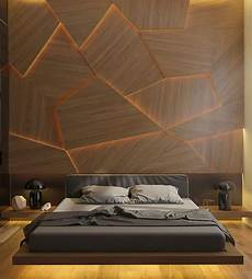 this bedroom has a geometric back lit wood accent wall bedrooms black bedroom design modern