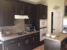 espresso beans by behr we painted our lightly stained oak cabinets in our home this color by