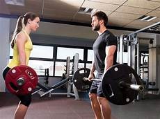 Fitness Male And Female | barbell man and woman workout at fitness gym stock image
