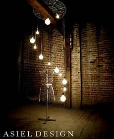 steunk hanging light bulbs vintage light bulb interior design rusty brick wall
