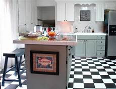 can you paint kitchen cabinets two colors in a small kitchen the decorologist