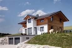 Hausbau Am Hang - tradition in modern massivholzhaus sonnleitner
