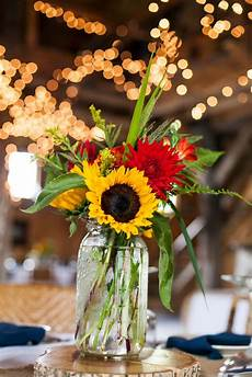 vibrant gerbera daisy and sunflower centerpieces