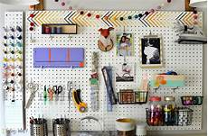 a colorful pegboard used for craft space