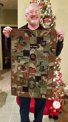 military career quilt cut up an old uniform and saved patches and stripes to make a memory
