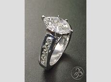 Engagement ring with 2.86ct marquise diamond and channel