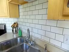 faux glass tile backsplash painted subway tile backsplash remodelaholic