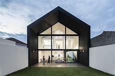 modern house remixes gabled shape with details