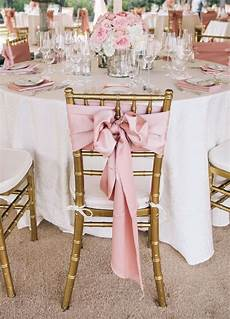pink bow on the back of each chair weddingchairs