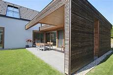 a combination of a flat and gable roof modern glass
