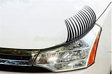 auto wimpern auf linkem scheinwerfer stockbild bild