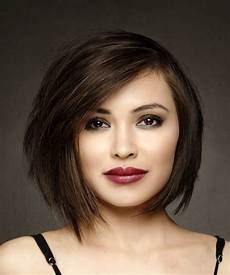 formal short straight bob hairstyle with side swept bangs