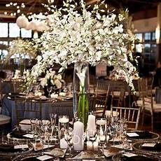 varying centerpieces above white inexpensive diy tall wedding centerpieces below