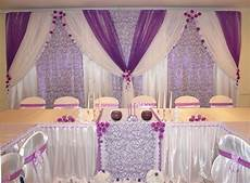 purple voile over lavender patterned and white drapes backdrop chuppah mandap wedding stage