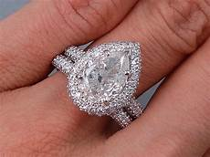 5 02 ctw pear shape diamond wedding ring g si3 i1 includes a matching wedding ring