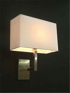 brushed nickel wall light with a white square shade