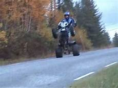 showing different wheelie tricks on a atv