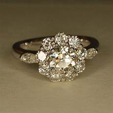 art deco inspired flower shaped engagement ring 14k and 18k white gold flower shaped
