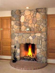 how to install river rock a fireplace surround hunker
