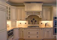 warm creams and caramels accentuate in pinehurst traditional kitchen raleigh by emma delon
