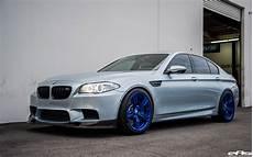 silverstone bmw m5 with blue wheels a custom exhaust