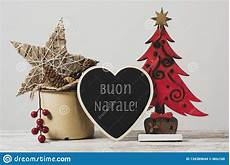 merry christmas in italian pictures ornaments and text merry christmas in italian image of house holidays 134389644
