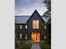 Dark grey vertical siding and steel roof make this modern