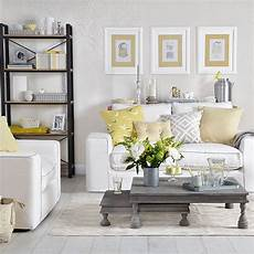 dove grey living room with yellow cushions living room decorating ideal home