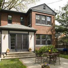 charcoal exterior trim looks great with the red brick might want a slightly darker color than