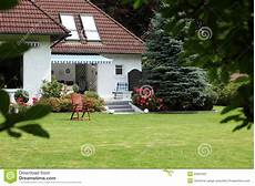house with landscaped garden stock photos image