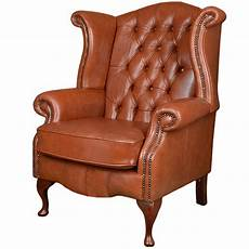 grain leather chesterfield scroll wing chair