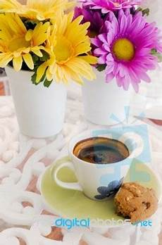 fiori coffee cup of coffee with flower stock photo royalty free image
