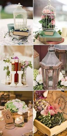 vintage themed wedding centerpieces with lanterns and books weddings marriage lantern