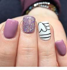cute light purple nails design with heart