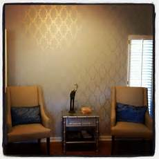 stenciled accent wall with metallic gold paint wonder if i could do a coral wall with gold