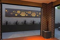 outdoor living area with feature wall art flower wave custom lightbox by entanglements