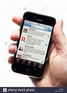 twiter mobile iphone smartphone smart phone mobile phone showing tweets