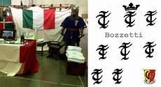 lettere gotiche minuscole a r a l d i c a per la divisa dell italian team alla