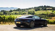 2017 aston martin db11 color ultramarine black location siena italy rear three quarter