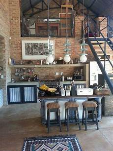 3 stylish and industrial inspired loft charming rustic interior of a two story high ceiling