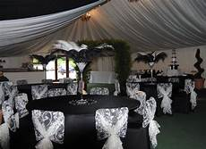 black and white wedding decor with lace patterned white hoods black chair covers weddings