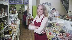 Happy Shop - portrait of a happy and successful shopkeeper in a
